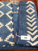 AN INDIAN DHURRIE RUG WITH BLUE GROUND AND GEOMETRIC DESIGN.