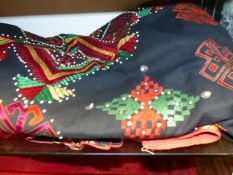 NORTHERN INDIAN TRIBAL CLOTHS WITH APPLIQUE AND MIRROR ROUNDALS.