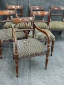 A SET OF SIX LATE GEORGIAN MAHOGANY DINING CHAIRS TO INCLUDE TWO ARMCHAIRS EACH WITH CARVED ROPE