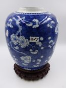 A CHINESE BLUE AND WHITE LARGE PRUNUS DECORATED GINGER JAR WITH DOUBLE ENCIRCLES FOUR CHARACTER MARK