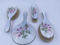 A HALLMARKED SILVER FIVE PIECE DRESSING TABLE SET DATED LONDON 1962 WITH A GUILLOCHE ENAMEL FLORAL