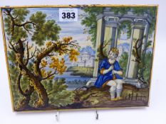 A 18th.C. ITALIAN MAJOLICA PANEL WITH A MUSICIAN SEATED IN AN ITALIANATE LANDSCAPE. 20 x 26cms.
