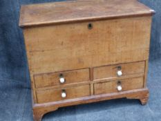 A 19th.C.COUNTRY PINE BLANKET CHEST WITH RISING TOP OVER FOUR SHORT DRAWERS ON BRACKET FEET. W.