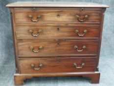 A GOOD GEO.III.MAHOGANY BATCHELOR'S CHEST WITH BRUSHING SLIDE OVER FOUR GRADUATED DRAWERS STANDING