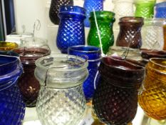A COLLECTION OF VARIED COLOUR GLASS TEA LIGHTS (33)