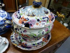A LARGE 19th.C.IRONSTONE TWIN HANDLED SOUP TUREEN AND UNDERTRAY WITH IMARI STYLE DECORATION.