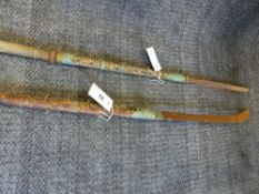 TWO JAPANESE POLEARMS, A NAGINATA WITH CURVED HEAVY TIPPED BLADE AND EBONISED EBU AND BRASS