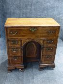 AN ANTIQUE INLAID OAK GEORGIAN KNEEHOLE DROP FRONT BUREAU WITH FITTED INTERIOR, CROSSBANDED WITH