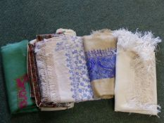 A QTY OF KASHMIRI AND OTHER WOVEN SCARVES.