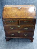 A SMALL INLAID WALNUT GEORGIAN SLANT FRONT BUREAU WITH FITTED INTERIOR AND TWO SHORT DRAWERS OVER