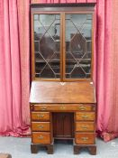 A 19th.C.MAHOGANY KNEEHOLE BUREAU WITH FALL FRONT AND FITTED INTERIOR OVER AN ARRANGEMENT OF SEVEN