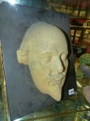 A DEATH MASK PORTRAIT OF WILLIAM SHAKESPEARE MOUNTED ON A SLATE SLAB. OVER ALL 38 x 30.5cms.