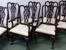 A SET OF EIGHT CARVED MAHOGANY DINING CHAIRS IN THE CHIPPENDALE TASTE TO INCLUDE TWO ARMCHAIRS.