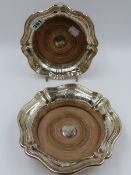 A VICTORIAN PAIR OF SILVER WINE COASTERS WITH FLUTED RIMS, SHEFFIELD 1846. DIA.18cms.