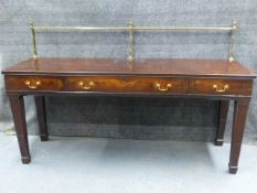 AN ANTIQUE AND LATER INLAID MAHOGANY GEORGIAN SIDEBOARD WITH BRASS RAIL ABOVE THREE APRON DRAWERS