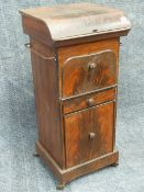 A 19th.C.TOLE PAINTED TIN WASHSTAND WITH RISING LID AND RECESSED BOWL OVER CUPBOARDS AND DRAWERS. W.