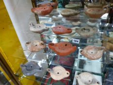 A GROUP OF TWELVE ROMAN POTTERY OIL LAMPS TO INCLUDE EXAMPLES DECORATED WITH ANIMALS, RELIGIOUS