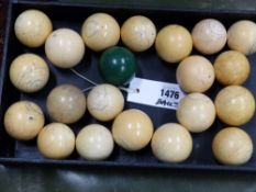 A COLLECTION OF EIGHTEEN ANTIQUE IVORY SNOOKER BALLS AND THREE OTHERS.