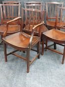 A GOOD SET OF SEVEN GEORGIAN COUNTRY OAK DINING CHAIRS WITH SHAPED PANEL SEATS.