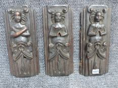 A SET OF THREE EARLY CARVED OAK ELEMENTS. H.33cms.