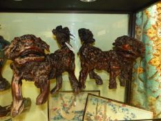 AN UNUSUAL PAIR OF CHINESE CARVED ROOTWOOD FIGURES OF STANDING FOO LIONS.