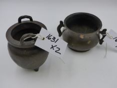 TWO CHINESE BRONZE TWIN HANDLE CENSERS, ONE WITH FLARED RIM AND SIDE HANDLES (H.7cms), THE OTHER