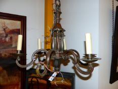 AN EARLY 20th.C.PATINATED BRONZE SIX LIGHT CHANDELIER IN THE DUTCH TASTE. H.55cms.