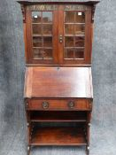 AN INTERESTING LATE 19th.C.ARTS AND CRAFTS OAK BUREAU BOOKCASE WITH GLAZED PANEL DOORS AND PAINTED