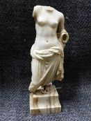 AN EARLY CARVED MARBLE FIGURAL FRAGMENT OF A SEMI-DRAPED FEMALE, LATER MOUNTED ON A MARBLE BASE.