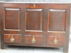 AN EARLY 18th.C.OAK MULE CHEST WITH PLANK TOP OVER THREE PANEL FRONT AND THREE DRAWER BASE. W.