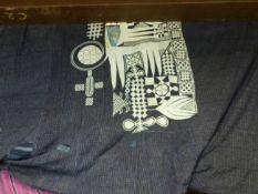 THREE NIGERIAN CEREMONIAL GARMENTS OF INDIGO BLUE AND APPLIQUED DECORATION.