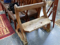 AN ANTIQUE SMALL PINE PEW OF PUGIN DESIGN.