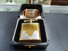 A 9ct GOLD FEDERAL WATCH TOGETHER WITH A DUNHILL LIGHTER.