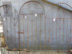 THREE WROUGHT IRON GATES.
