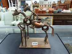 A METAL HORSE AND RIDER DECORATIVE FIGURE.