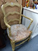 A CONTINENTAL PAINTED LADDER BACK ARMCHAIR.