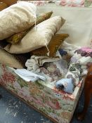 A LARGE VICTORIAN UPHOLSTERED OTTTOMAN TOGETHER WITH A LARGE QTY OF LINENS, TEXTILES,ETC