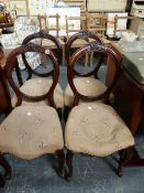 A SET OF FOUR VICTORIAN BALLOON BACK CHAIRS.