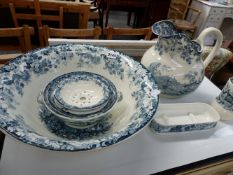 A VICTORIAN WASH JUG AND BASIN SET BY MNTONS.