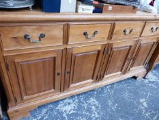 A LARGE VICTORIAN STYLE PINE FOUR DOOR DRESSER BASE.