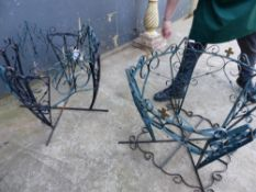 TWO SIMILARLY PAINTED WROUGHT IRON TABLE BASES.