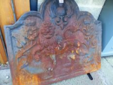 A LARGE CAST IRON FIRE BACK.