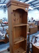 A SMALL PINE NARROW BOOKCASE AND TWO LOW TEAK BOOKCASES.