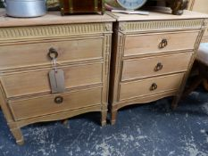 A PAIR OF PINE THREE DRAWER BEDSIDE CHESTS.