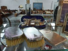 A SILVER CIGARETTE BOX, BRUSHES,NAPKIN RINGS, ETC.