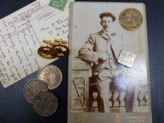 COINS, POSTCARDS, AND CUFFLINKS.
