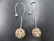 A PAIR OF WHITE METAL LARGE DROP EARRINGS.