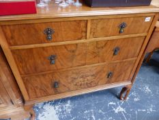 A WALNUT CHEST OF TWO SHORT AND TWO LONG DRAWERS ON CABRIOLE LEGS.