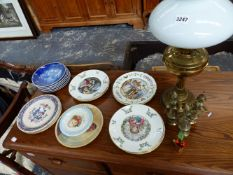 AN OIL LAMP AND A COLLECTION OF VARIOUS CHRISTMAS PLATES TO INCLUDE DOULTON AND COPENHAGEN.
