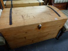 AN ANTIQUE PINE DOME TOP BLANKET BOX.